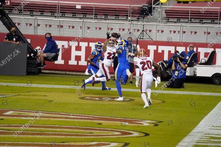 San Francisco 49ers cornerback Jason Verrett (22) intercepts a pass in the end zone between Los Angeles Rams wide receiver Robert Woods, left, and Josh Reynolds during the second half of an NFL football game in Santa Clara, Calif