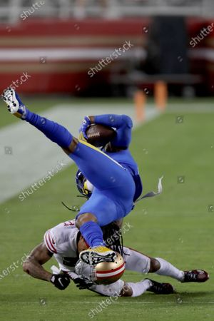 Los Angeles Rams tight end Gerald Everett (81) is brought down by San Francisco 49ers cornerback Jason Verrett (22) in the second half during an NFL football game against the San Francisco 49ers, in Santa Clara, Calif