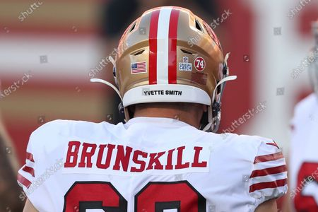 San Francisco 49ers offensive guard Daniel Brunskill wears the name Yvette Smith on his helmet with a logo for a Crucial Catch and a number 74 decal to honor former 49ers player Fred Dean, who died Oct. 14, 2020, before an NFL football game against the Los Angeles Rams in Santa Clara, Calif