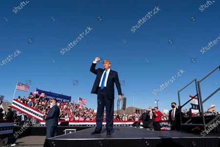 President Donald Trump arrives to speak at a campaign rally at Carson City Airport, in Carson City, Nev