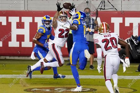 Stock Picture of San Francisco 49ers cornerback Jason Verrett (22) intercepts a pass in the end zone between Los Angeles Rams wide receiver Robert Woods, left, and Josh Reynolds during the second half of an NFL football game in Santa Clara, Calif