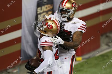 San Francisco 49ers cornerback Jason Verrett, foreground, celebrates after intercepting a pass against the Los Angeles Rams during the second half of an NFL football game in Santa Clara, Calif