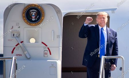 President Donald Trump greets supporters as he arrives on Air Force One at John Wayne Airport on Sunday, Oct. 18, 2020 in Santa Ana, CA where he will be attending a fundraiser at the home of Palmer Luckey in Newport Beach. (Allen J. Schaben / Los Angeles Times)
