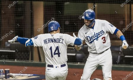 Los Angeles Dodgers second baseman Kike Hernandez (L) celebrates with Los Angeles Dodgers second baseman Chris Taylor (R) after hitting a home run in the sixth inning of the MLB National League Championship Series baseball game seven between the Los Angeles Dodgers and the Atlanta Braves at Globe Life Field in Arlington, Texas, USA, 18 October 2020.