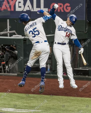 Los Angeles Dodgers center fielder Cody Bellinger (L) celebrates with Los Angeles Dodgers second baseman Kike Hernandez  (R) after hitting a home run in the seventh inning of the MLB National League Championship Series baseball game seven between the Los Angeles Dodgers and the Atlanta Braves at Globe Life Field in Arlington, Texas, USA, 18 October 2020.