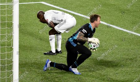 Los Angeles FC forward Bradley Wright-Phillips, left, reacts to Portland Timbers goalkeeper Steve Clark, right, stopping his shot during the first half of an MLS soccer match in Portland, Ore