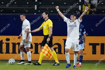 Los Angeles Galaxy's Cristian Pavon (10) celebrates after a 1-0 win over the Vancouver Whitecaps in an MLS soccer match, in Carson, Calif