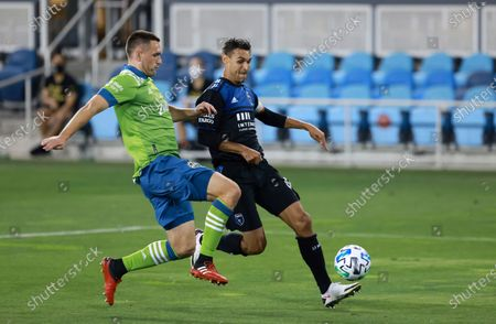 Seattle Sounders defender Shane O'Neill, left, battles for the ball against the San Jose Earthquakes forward Chris Wondolowski during the first half of an MLS soccer match, in San Jose, Calif