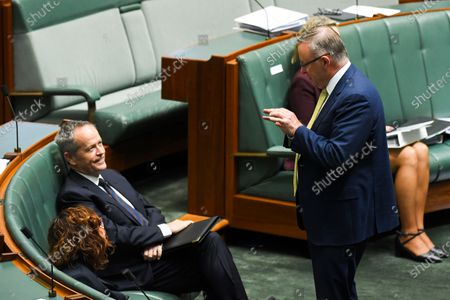 Australian Opposition Leader Anthony Albanese (R) speaks to former Australian Opposition Leader Bill Shorten (L) during House of Representatives Question Time at Parliament House in Canberra, Australia, 19 October 2020.
