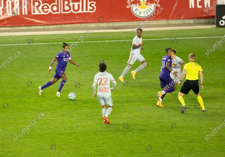 Nani (17) of Orlando City SC controls ball during regular MLS game against Red Bulls at Red Bull Arena. Game ended in draw 1 - 1. Game was played without fans because of COVID-19 pandemic precaution. All supporting staff and players on the bench were wearing facial masks and kept social distances.