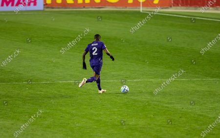 Ruan (2) of Orlando City SC controls ball during regular MLS game against Red Bulls at Red Bull Arena. Game ended in draw 1 - 1. Game was played without fans because of COVID-19 pandemic precaution. All supporting staff and players on the bench were wearing facial masks and kept social distances.