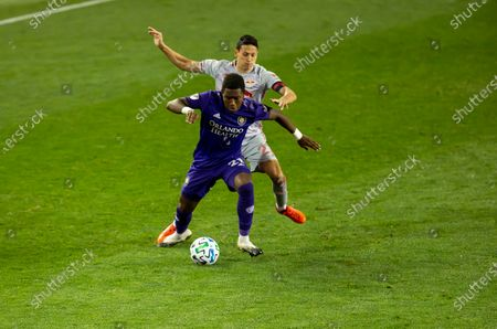 Andres Perea (21) of Orlando City SC controls ball during regular MLS game against Red Bulls at Red Bull Arena. Game ended in draw 1 - 1. Game was played without fans because of COVID-19 pandemic precaution. All supporting staff and players on the bench were wearing facial masks and kept social distances.