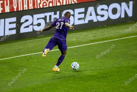 Kamal Miller (27) of Orlando City SC controls ball during regular MLS game against Red Bulls at Red Bull Arena. Game ended in draw 1 - 1. Game was played without fans because of COVID-19 pandemic precaution. All supporting staff and players on the bench were wearing facial masks and kept social distances.