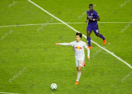 Florian Valot (22) of Red Bulls controls ball during regular MLS game against Orlando City SC at Red Bull Arena. Game ended in draw 1 - 1. Game was played without fans because of COVID-19 pandemic precaution. All supporting staff and players on the bench were wearing facial masks and kept social distances.