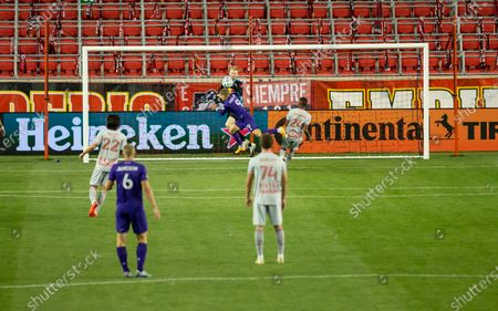 Goalkeeper Ryan Meara (18) of Red Bulls saves as Chris Mueller (9) of Orlando City SC charges during regular MLS game at Red Bull Arena. Game ended in draw 1 - 1. Game was played without fans because of COVID-19 pandemic precaution. All supporting staff and players on the bench were wearing facial masks and kept social distances.