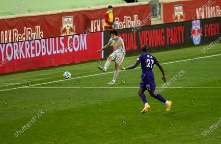 Caden Clark (37) of Red Bulls kicks ball during regular MLS game against Orlando City SC at Red Bull Arena. Game ended in draw 1 - 1. Game was played without fans because of COVID-19 pandemic precaution. All supporting staff and players on the bench were wearing facial masks and kept social distances.