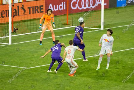 Antonio Carlos (25) of Orlando City SC controls air ball during regular MLS game against Red Bulls at Red Bull Arena. Game ended in draw 1 - 1. Game was played without fans because of COVID-19 pandemic precaution. All supporting staff and players on the bench were wearing facial masks and kept social distances.