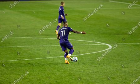 Junior Urso (11) of Orlando City SC controls ball during regular MLS game against Red Bulls at Red Bull Arena. Game ended in draw 1 - 1. Game was played without fans because of COVID-19 pandemic precaution. All supporting staff and players on the bench were wearing facial masks and kept social distances.