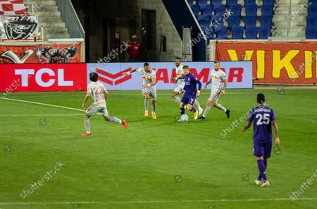 Chris Mueller (9) of Orlando City SC controls ball during regular MLS game against Red Bulls at Red Bull Arena. Game ended in draw 1 - 1. Game was played without fans because of COVID-19 pandemic precaution. All supporting staff and players on the bench were wearing facial masks and kept social distances.