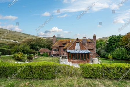 An impressive cliff-top home where Laurence Olivier honeymooned is on the market for £1.75m.  Weston is in an outstanding coastal position, in Lulworth Cove, Dorset, with views of the popular Durdle Door beauty spot, as well as Weymouth Bay, Portland and the Purbecks.  The Grade II listed house was designed by Sir Edwin Lutyens and is thought to be the only example of his work in Dorset.  The seven-bedroom property was built in the 1920s and is now in need of some refurbishment and modernisation.