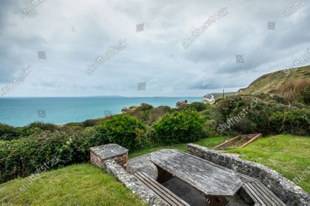 Stock Picture of Gardens.   An impressive cliff-top home where Laurence Olivier honeymooned is on the market for £1.75m.  Weston is in an outstanding coastal position, in Lulworth Cove, Dorset, with views of the popular Durdle Door beauty spot, as well as Weymouth Bay, Portland and the Purbecks.  The Grade II listed house was designed by Sir Edwin Lutyens and is thought to be the only example of his work in Dorset.  The seven-bedroom property was built in the 1920s and is now in need of some refurbishment and modernisation.