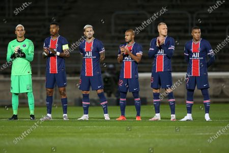 L-R: Paris Saint-Germain's players Kellor Navas, Presnel Kimpembe, Leandro Paredes, Rafinha, Mitchel Bakker and Kylian Mbappe pose prior the French L1 football match between Nimes (NO) and Paris Saint Germain (PSG) at the Costieres Stadium in Nimes, southern France, on October 16, 2020.