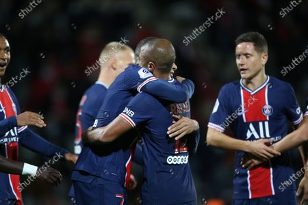 Paris Saint-Germain's Kylian Mbappe and Rafinha celebrate during the French L1 football match between Nimes (NO) and Paris Saint Germain (PSG) at the Costieres Stadium in Nimes, southern France, on October 16, 2020.