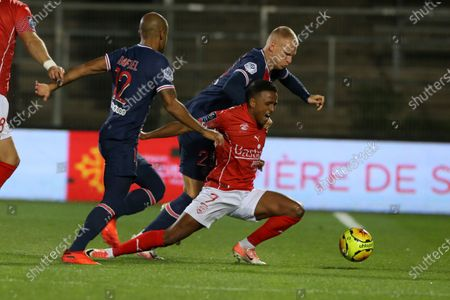 Paris Saint-Germain's players Rafinha and Bakker challenge Nimes' Eliason during the French L1 football match between Nimes (NO) and Paris Saint Germain (PSG) at the Costieres Stadium in Nimes, southern France, on October 16, 2020.