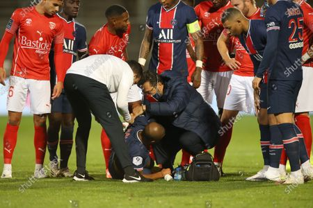 Paris Saint-Germain's Rafinha lays on ground during the French L1 football match between Nimes (NO) and Paris Saint Germain (PSG) at the Costieres Stadium in Nimes, southern France, on October 16, 2020.
