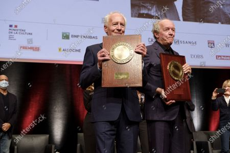 Luc Dardenne (L) and Jean-Pierre Dardenne (R) attend the tribute to the brothers Jean-Pierre and Luc Dardenne at the 12th Film Festival Lumiere in Lyon.