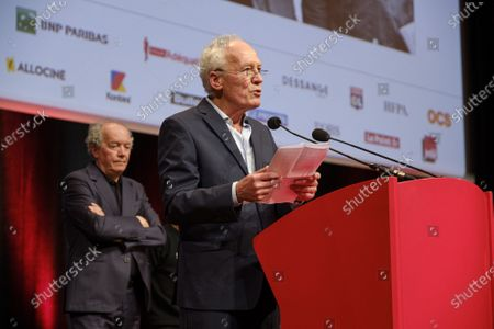 Luc Dardenne (R) and Jean-Pierre Dardenne (L) attend the tribute to the brothers Jean-Pierre and Luc Dardenne at the 12th Film Festival Lumiere in Lyon.