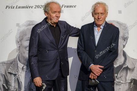 Stock Image of Luc Dardenne (R) and Jean-Pierre Dardenne (L) attend the tribute to the brothers Jean-Pierre and Luc Dardenne at the 12th Film Festival Lumiere in Lyon.