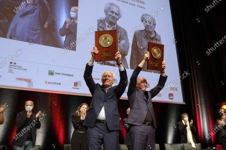 Stock Picture of Luc Dardenne (R) and Jean-Pierre Dardenne (L) attend the tribute to the brothers Jean-Pierre and Luc Dardenne at the 12th Film Festival Lumiere in Lyon.