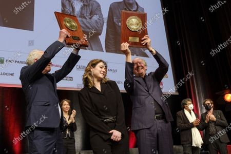 Luc Dardenne, Emilie Dequenne and Jean-Pierre Dardenne attend the tribute to the brothers Jean-Pierre and Luc Dardenne at the 12th Film Festival Lumiere in Lyon.