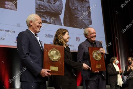 Stock Image of Luc Dardenne, Emilie Dequenne and Jean-Pierre Dardenne attend the tribute to the brothers Jean-Pierre and Luc Dardenne at the 12th Film Festival Lumiere in Lyon.
