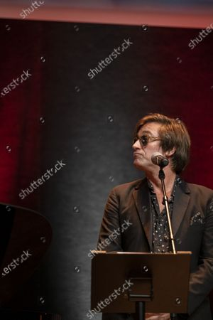 Stock Picture of Thomas Dutronc performs during the tribute to the brothers Jean-Pierre and Luc Dardenne at the 12th Film Festival Lumiere in Lyon.
