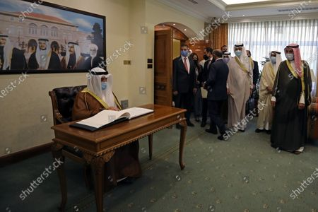 Kuwaiti Foreign Minister Sheikh Ahmad Nasser al-Mohammad al-Sabah signs the guest book before the meeting with Jordanian Foreign Minister Ayman Safadi in Amman, Jordan, 19 October 2020.