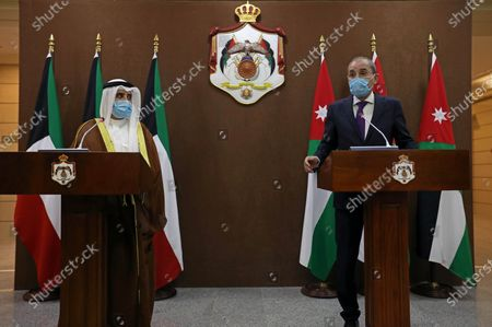 Jordanian Foreign Minister Ayman Safadi (R), speaks during a news conference with his Kuwaiti counterpart Sheikh Ahmad Nasser al-Mohammad al-Sabah in Amman, Jordan, 19 October 2020.