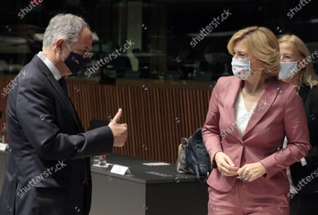 German Minister of Food, Agriculture and Consumer Protection Julia Kloeckner, right, speaks with Cyprus' Agriculture Minister Costas Kadis during a meeting of EU agriculture ministers at the European Council building in Luxembourg