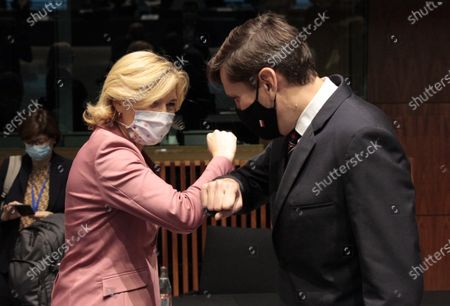 German Minister of Food, Agriculture and Consumer Protection Julia Kloeckner, left, greets Poland's Minister of Agriculture and Forestry Grzegorz Puda with an elbow bump during a meeting of EU agriculture ministers at the European Council building in Luxembourg