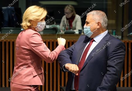 German Minister of Food, Agriculture and Consumer Protection Julia Kloeckner (L) elbows with Malta's Minister of Agriculture Anton Refalo (R) prior to an EU Agriculture and Fisheries council ministers meeting in Luxembourg, 19 October 2020.