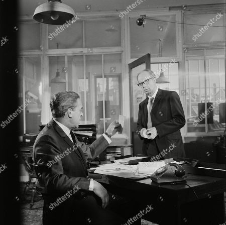 Stock Photo of Eddie Byrne as Frank Bellman and Toke Townley as George Parsons