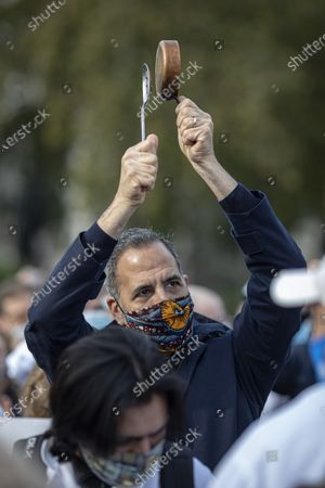Celebrity chef Yotam Ottolenghi joins hospitality workers to wave placards and bang pans in Parliament Square during a protest against the impact COVID-19 restrictions are having on the hospitality industry.