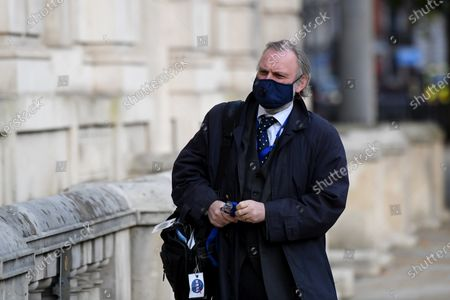 Sir Tim Barrow, British Ambassador to the EU, arrives at the Cabinet Office.