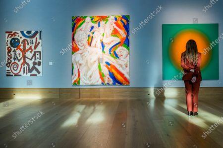 Stock Image of A. R. Penck, Standart TTABTTT 5, 1984, £110,000 - 160,000, and Salomé (Wolfgang Ludwig Cihlarz), Zeittunnel, 1981, £ 9,000 - 12,000 with Peter Schuyff, Untitled, 1987, est £ 6,000 - 8,000 - Preview of Bonhams' Post-War & Contemporary Art sale,in new Bond Street.