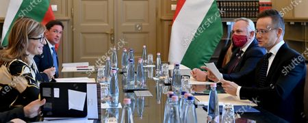 Hungarian Minister of Foreign Affairs and Trade Peter Szijjarto (R) and Bulgarian Deputy Prime Minister and Minister of Foreign Affairs Ekaterina Zaharieva (L) speak during their meeting in Budapest, Hungary, 19 October 2020.