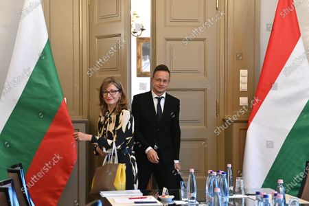 Hungarian Minister of Foreign Affairs and Trade Peter Szijjarto (R) welcomes the Bulgarian Deputy Prime Minister and Minister of Foreign Affairs Ekaterina Zaharieva in his office in Budapest, Hungary, 19 October 2020.