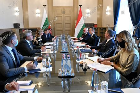 Hungarian Minister of Foreign Affairs and Trade Peter Szijjarto (R-3) and Bulgarian Deputy Prime Minister and Minister of Foreign Affairs Ekaterina Zaharieva (L-3) speak during their meeting in Budapest, Hungary, 19 October 2020.