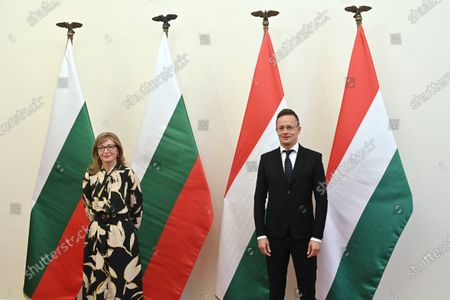 Hungarian Minister of Foreign Affairs and Trade Peter Szijjarto (R) welcomes Bulgarian Deputy Prime Minister and Minister of Foreign Affairs Ekaterina Zaharieva in his office in Budapest, Hungary, 19 October 2020.