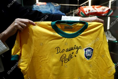 A Brazil national team jersey signed by legendary Brazilian footballer Pele is presented prior to be be auctioned at the 'I art and sport international solidarity auction'  at the Ansorena auction house in Madrid, Spain, 19 October 2020. The collected benefits of the 'I art and sport international solidarity auction' will be used by the Real Madrid fundation in Centers for Minors and for people with disabilities.